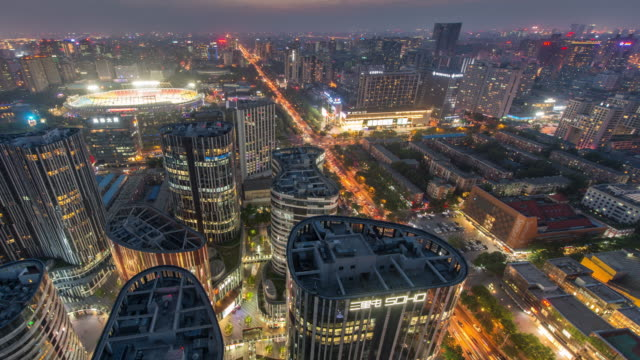 Time Lapse - Aerial View of Sanlitun, Beijing City Lines, Dusk to Night Transition video