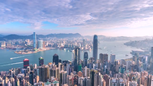 4k time lapse aerial view  of victoria harbor, hong kong - hong kong video stock e b–roll