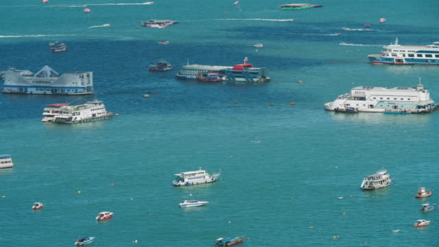 Time Lapse: Aerial view; Tourist travel on clean Beautiful sea surface.