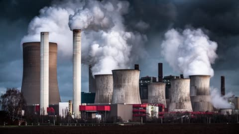 Time Lapse: Air Pollution by coal fired power station Chimneys and cooling towers from a coal fired power station releasing smoke and steam into the atmosphere. The power plant is also releasing CO2 which contributes to global warming and climate change. factory stock videos & royalty-free footage