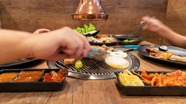 time lapse: asians are grilling bbq in korean restaurants. food concept - buffet video stock e b–roll