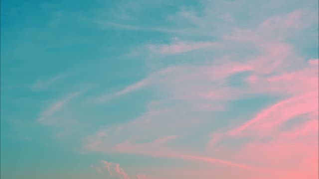 4K Time lapse, beautiful blue pastel sky with clouds background.Sky clouds.Sky with clouds weather nature cloud blue.Blue sky with clouds and sun.