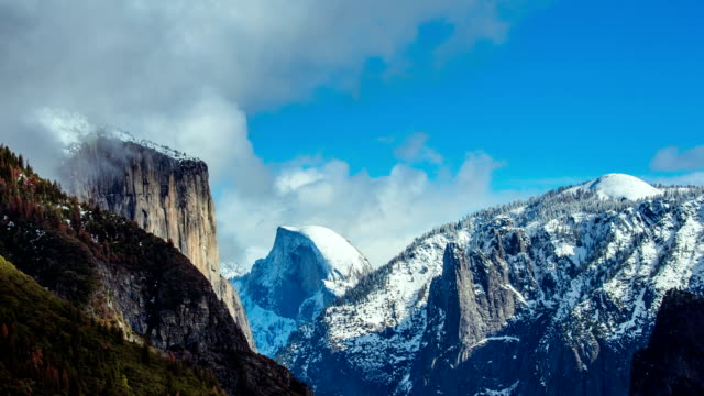 Time Lapse - Beautiful Clouds Moving Over Snowy Yosemite Mountains and Half Done