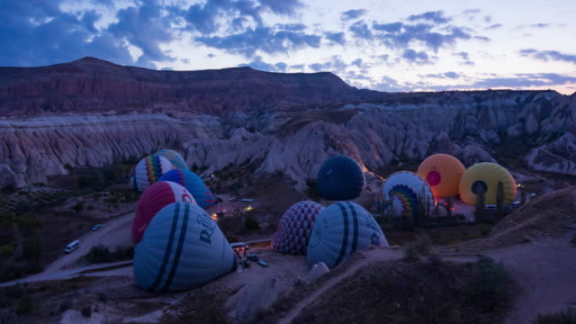 Time lapse : Beautiful Hot Air Balloons flying over rock landscape Goreme National Park Cappadocia  at Turkey
