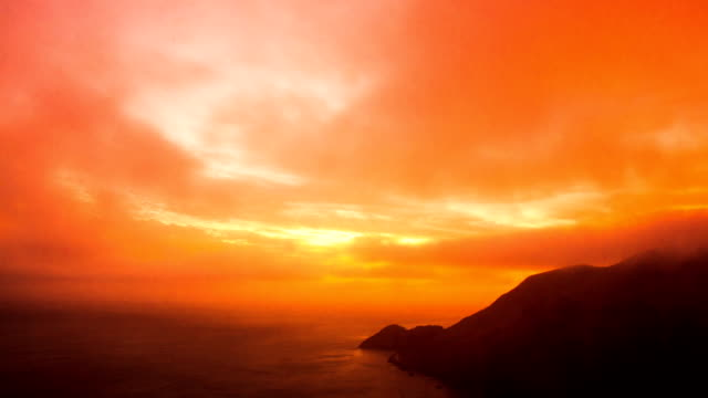 Time Lapse - Beautiful Orange Clouds Moving Over the Ocea video