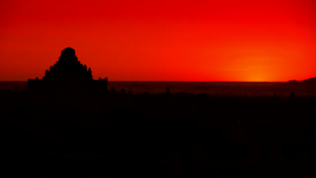 Time lapse Beautiful sunrise over the ancient pagodas in Bagan, Myanmar. Time lapse Beautiful sunrise over the ancient pagodas in Bagan, Myanmar.The capital of the ancient Pagan Kingdom  located in the Mandalay Region of Myanmar.Bagan's prosperous economy built over 10,000 temples between the 11th and 13th centuries. bagan stock videos & royalty-free footage