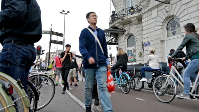 Time lapse bicycle commuters and pedestrians in Amsterdam video
