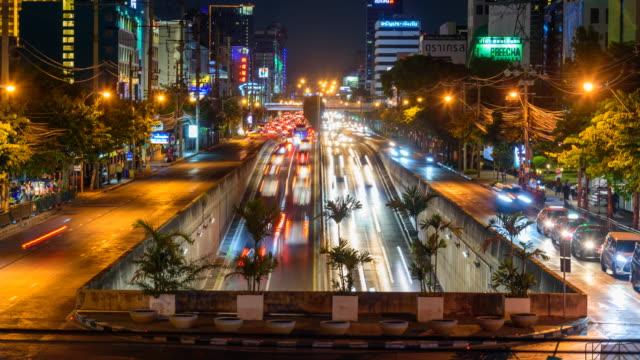 Time lapse blur light a lot of car traffic at u-turn street in Bangkok city