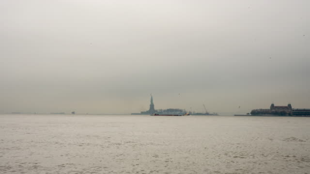 WS Time lapse boats and ferries moving along Upper New York Bay with Statue of Liberty in background,United States