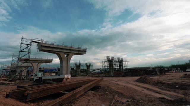 Time lapse bridge concrete construction through and sunset