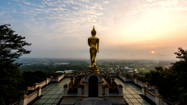 Time lapse - Buddha standing on a mountain in the morning at Wat Phra That Khao Noi, Nan Province, Thailand video