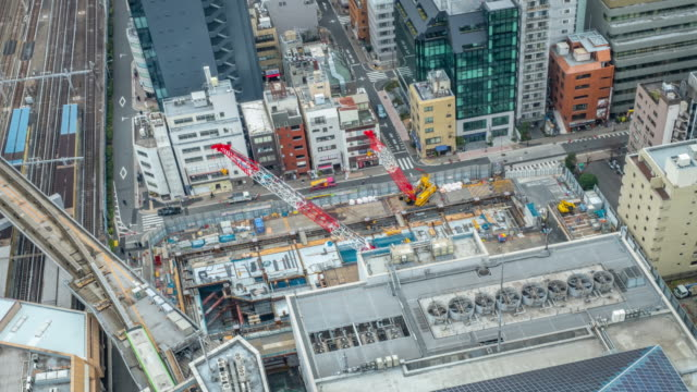 4kタイムラプス - 日本鉄道で建造構造 - 東京 - クレーン点の映像素材/bロール