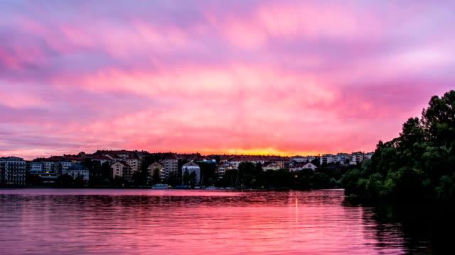 hd time lapse: buildings at dusk - summer sweden bildbanksvideor och videomaterial från bakom kulisserna