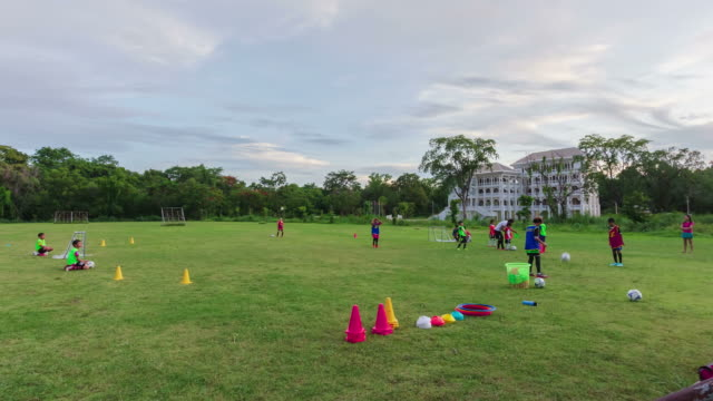 4K time lapse, Child practice soccer in field video