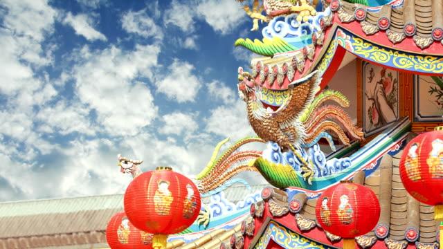 time lapse chinese phoenix on temple roof - smok postać fikcyjna filmów i materiałów b-roll