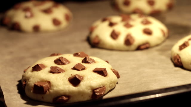 Time lapse - Chocolate Cookies Baking in the Oven Time lapse - Chocolate American Cookies Baking in the Oven Full HD cookie stock videos & royalty-free footage