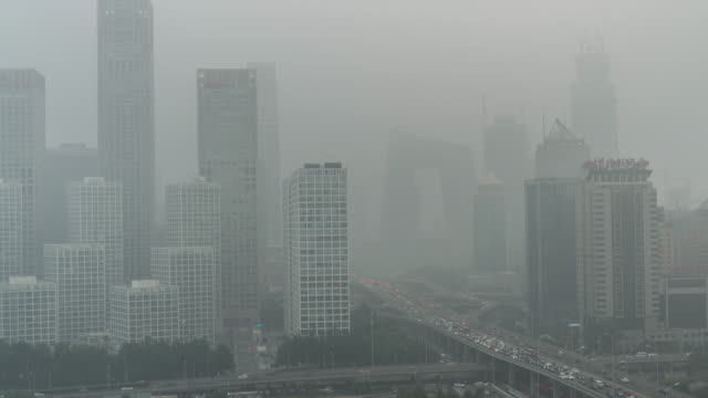 time lapse- city under siege-beijing air pollution (zoom) - smog video stock e b–roll