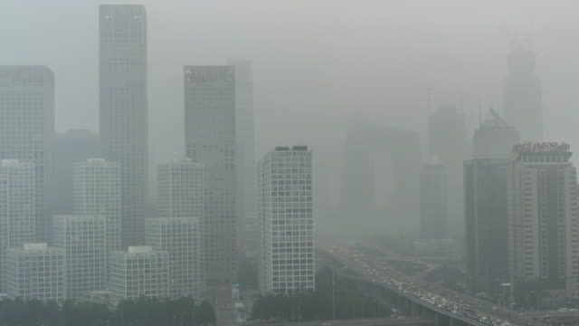 time lapse- cityscape of beijing in air pollution - смог над городом стоковые видео и кадры b-roll