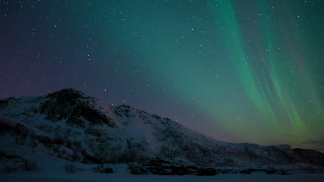 time lapse clip of polar light or northern light (aurora borealis) in the night sky over the lofoten islands in northern norway in winter. - aurora boreale video stock e b–roll