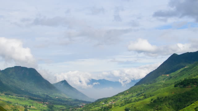 Time lapse close up to mountain with cloudscape in Sapa, Vietnam The cloud is moving along mountain range with light effect sa pa stock videos & royalty-free footage