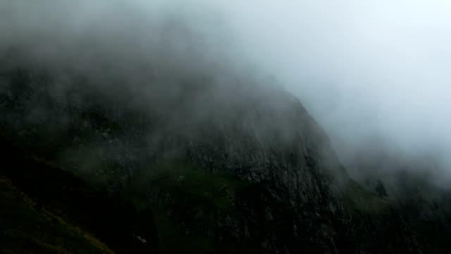 Time lapse clouds float in the valley under the iconic swiss mountain Eiger near Grindelwald village Bern region Switzerland Alps travel Europe wanderlust video