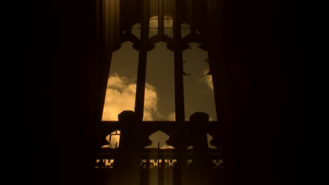 Time lapse clouds through arched church window video