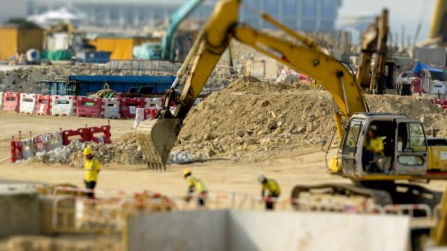 vidéos et rushes de styles de time lapse construction à hong kong.panning 4k. - chantier