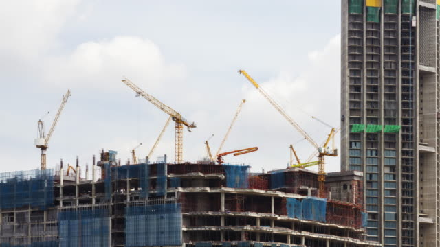 4K Time Lapse Construction : Many Crane working in Big Construction Site for industry.zoom in styles video