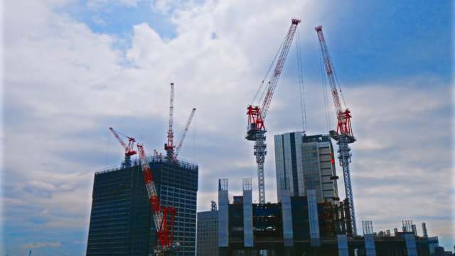 4K Time lapse crane and building under construction 4K Time lapse crane and building under construction construction machinery stock videos & royalty-free footage