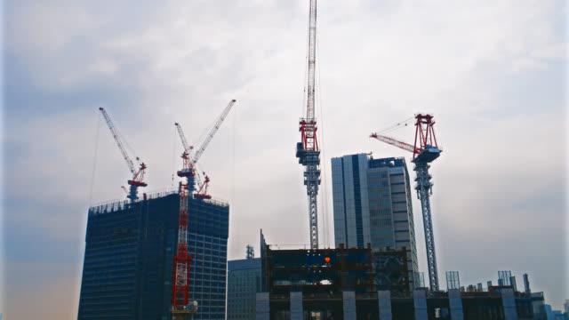 4K Time lapse crane and building under construction
