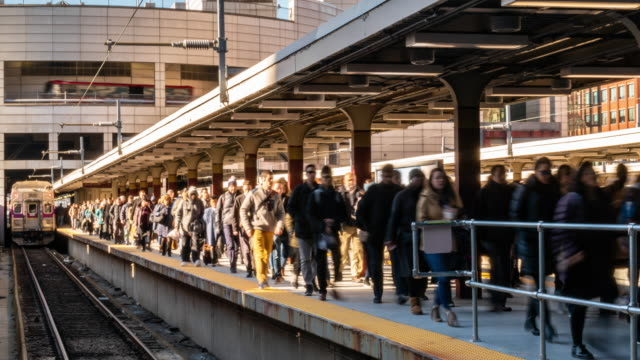 Time lapse crowd of passenger and tourist walking in railroad station platform