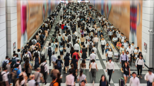 4k time lapse crowd of pedestrians walking in subway transportation hub in rush hour, hong kong - escalator video stock e b–roll