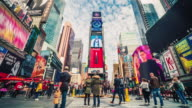 istock Time lapse crowd of tourist walking at Times Square, United States 1209902371