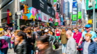 istock Time lapse crowd of tourist walking at Times Square 1225730948