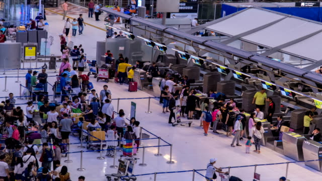 HD Time Lapse : Crowd of traveller at airport check in video