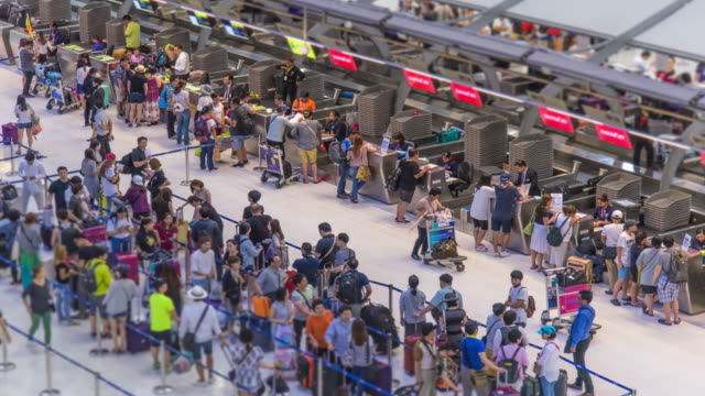 Time Lapse : Crowd of travellers at airport check in zone video