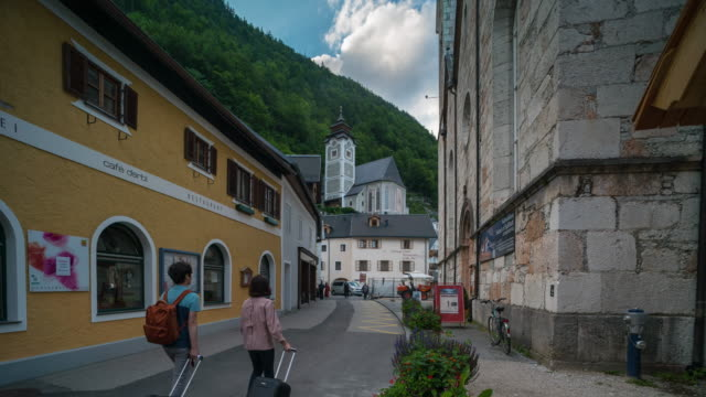 time lapse, crowd waking at hallstatt downtown, austria - neoclassical architecture stock videos & royalty-free footage