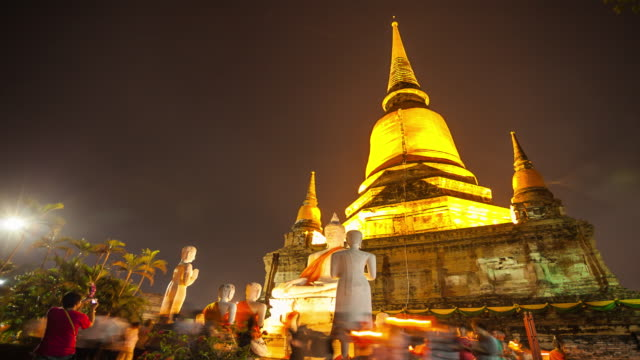 Time Lapse: Crowd walking with Candle Light at Wat Yai Chaimongkol in Ayutthaya of Thailand. video