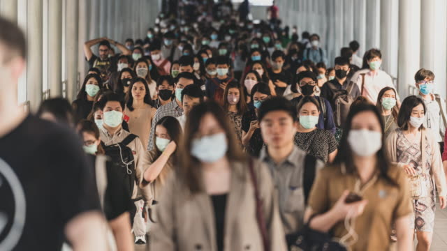 time lapse crowded of people wearing a face mask to prevent coronavirus or covid19 outbreak - businessman covid mask video stock e b–roll