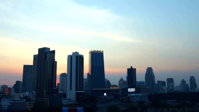 Time Lapse D2N Cityscape with dramatic sky at downtown Bangkok 4K Aerial view Time Lapse Day to Night Cityscape with dramatic sky over Rama IV Rd., downtown Bangkok, Thailand sunset to night time lapse stock videos & royalty-free footage