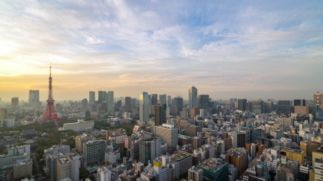 4K UHD time lapse day to night of Tokyo city skyline view and building at Japan with sunset and colorful skyline. Beautiful of cloud and sky in dusk and twillight.