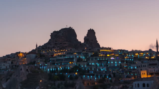 Time Lapse : Day to Night Panoramic Uchisar castle ancient cave houses near Goreme, Cappadocia, Turkey