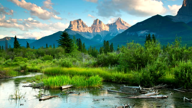 Time lapse Dolly movement of mountains, clouds and meadow stream video