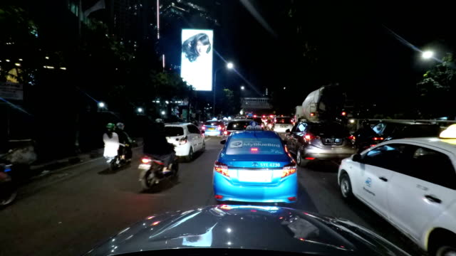 POV time lapse driving in jakarta Time lapse POV night driving at jakarta traffic. traffic time lapse stock videos & royalty-free footage