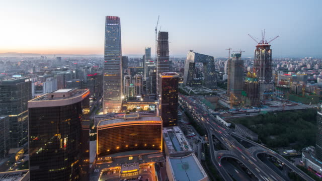 Time Lapse- Elevated View of Beijing Skyline at Dusk, from Day to Night (Zoom Out) video