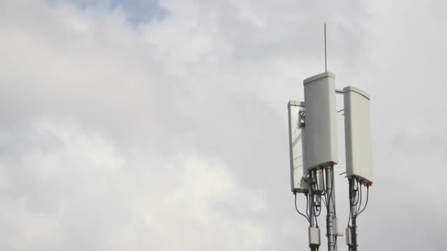 Time lapse footage of a 3G 4G antenna isolated over the cloudy sky