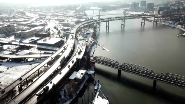 A time lapse footage of busy traffics on the bridges and highways in the sunshine after snow falls video