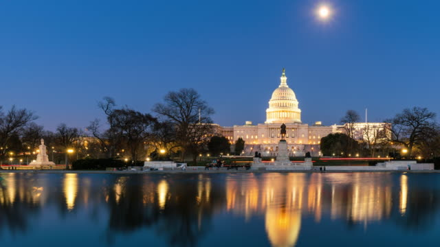 4K Time lapse front of the United States Capitol Building with reflecting pool at twilight time, Capitol Hill, Washington, D.C., USA Time lapse front of the United States Capitol Building with reflecting pool at twilight time, Capitol Hill, Washington, D.C., USA, 4k clip white house stock videos & royalty-free footage
