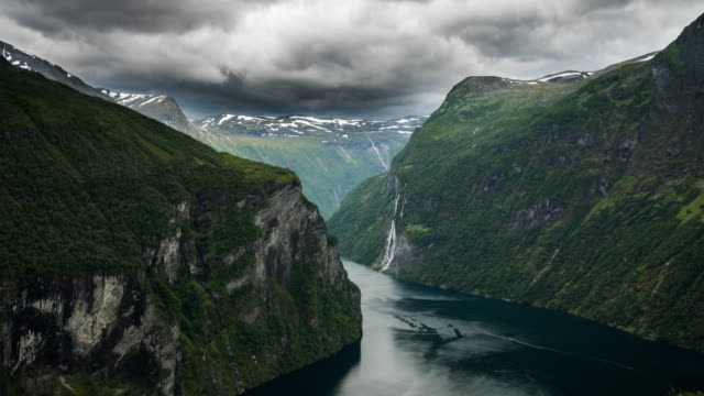 Time Lapse: Geirangerfjord, Romsdal county, Norway Time lapse shot of the majestic, UNESCO-protected, Geirangerfjord in the Møre og Romsdal region of Norway. scandinavia stock videos & royalty-free footage