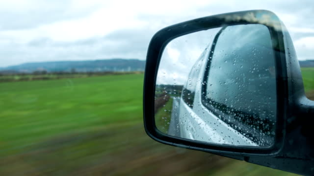 Time lapse glass side mirror car background with rural view Time lapse glass side mirror car background with rural view uk border stock videos & royalty-free footage